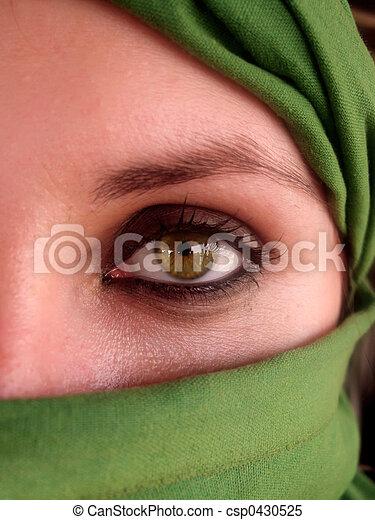 intense green eyes of arabian girl - csp0430525
