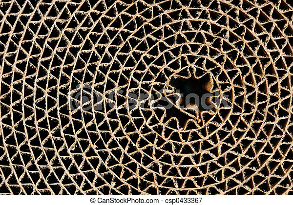 Webbed circle made of brown corrugated cardboard