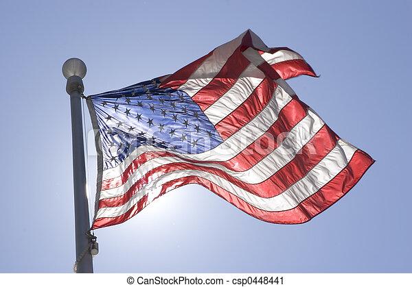 Stock Photography of Flag - Sun illuminating a waving flag