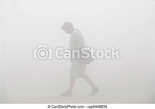 Man walking in a fog - csp0448834