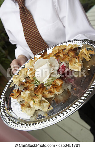Serving tasty snacks on a silver platter - csp0451781