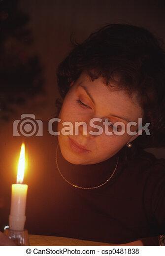 Candle Gazing Lady - csp0481838