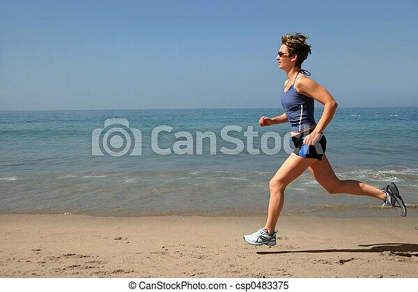 Exercising on the beach - csp0483375