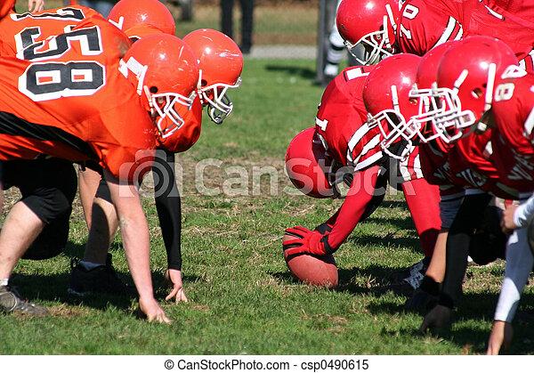 Football Team Ready to Hike Ball - csp0490615