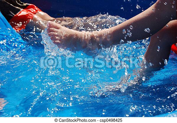 Kicking in Kiddie Pool - csp0498425