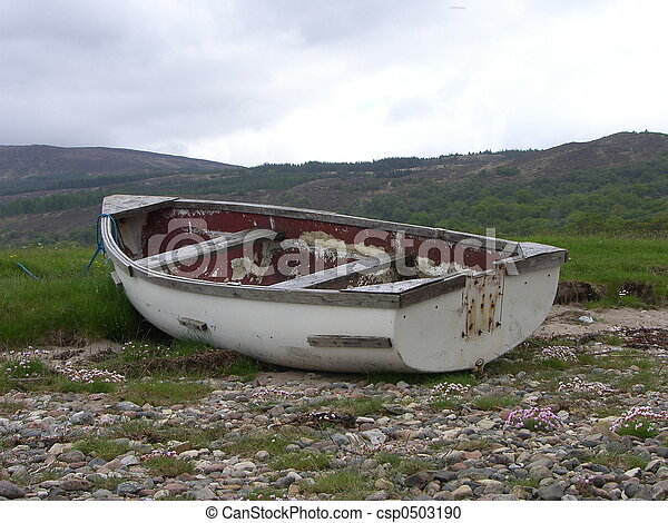 Stock Photography of Beached Row Boat - Old row boat pulled up on ...