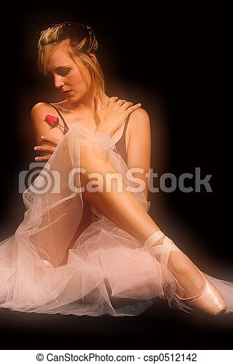 A ballerina, with rose - soft focus. - csp0512142