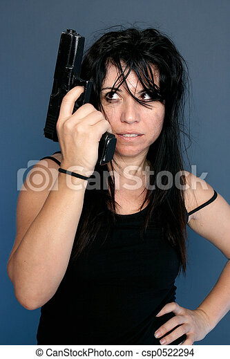 Stock Photo of Gangster Girl - Grungy looking girl holding a gun ...