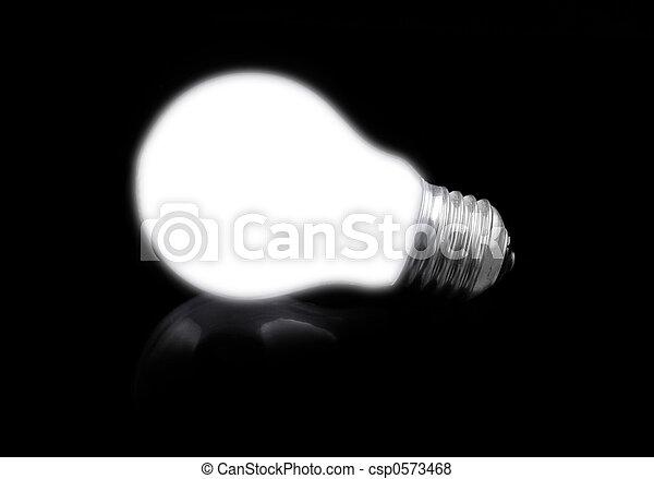 close-up of lit light bulb on black - csp0573468