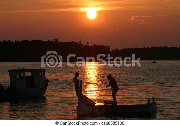 Swimming at Sunset - csp0585100