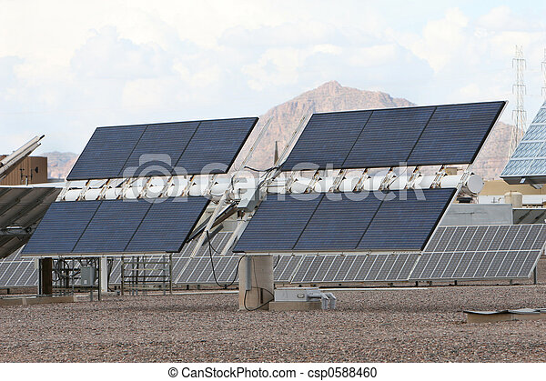 Solar panels in front of desert mountains in Arizona. Good for issues about power, air pollution, global warming, etc. - csp0588460