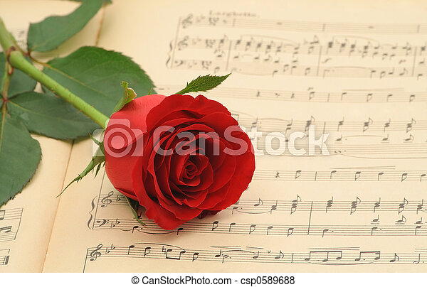Old sheet music with rose - csp0589688