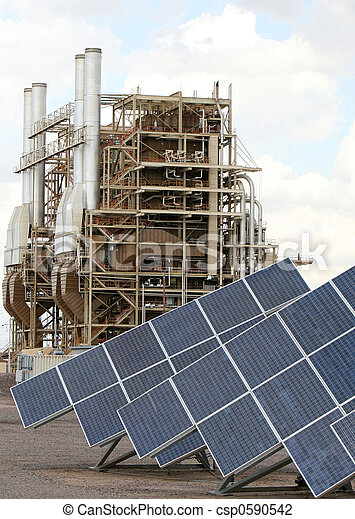 Solar panels in front of a traditional power plant in Arizona. Good for issue about power, air pollution, global warming, etc. - csp0590542