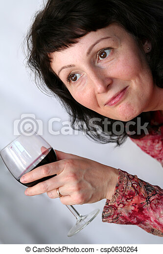 Beautiful mature brunette with glass of wine. Save Comp