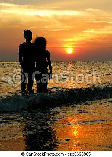 couple on beach. sunrise. - csp0630865