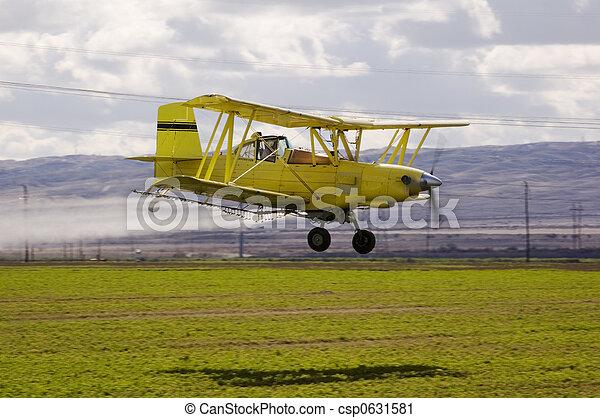 Crop duster spraying fields - csp0631581