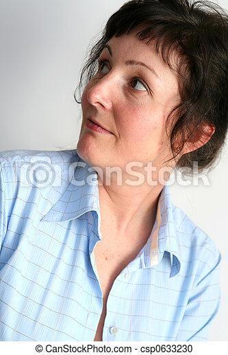 Beautiful mature brunette woman wearing blue shirt. Save Comp