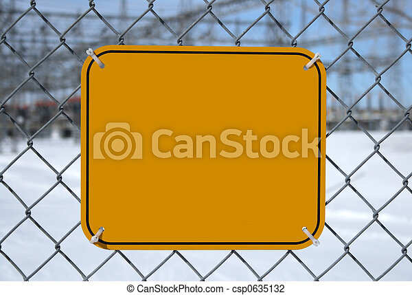 Blank high voltage danger sign with copy space at the chain link fence of a power station.