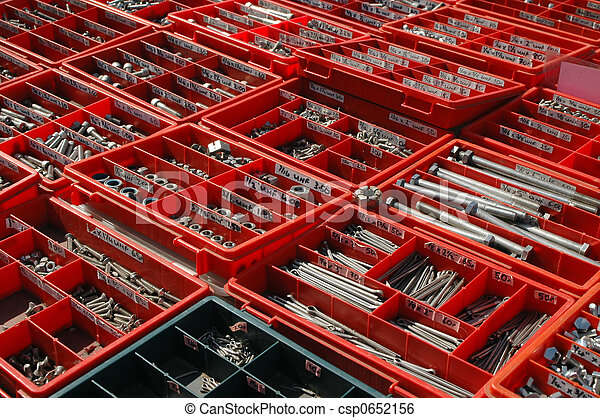 large selection of assorted nuts and bolts in red trays