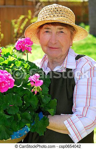 photo de personne agee femme jardinage personne agee femme csp0654042 recherchez des. Black Bedroom Furniture Sets. Home Design Ideas