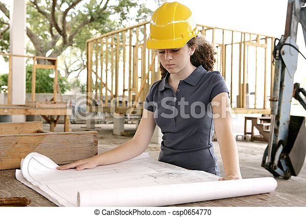 Engineering Student Reads Blueprints - csp0654770