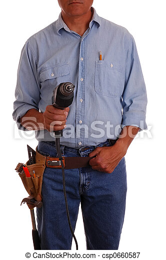 Carpenter in toolbelt holding drill - csp0660587