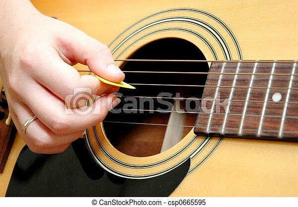 Playing Guitar - csp0665595