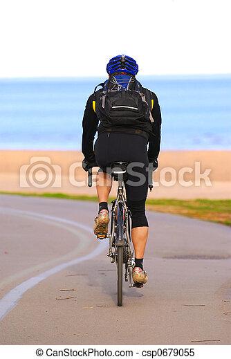 Riding bicycle - csp0679055