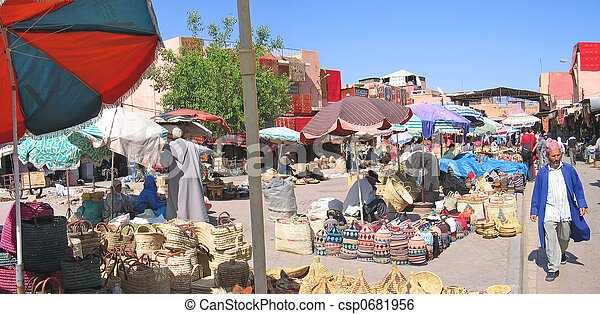 Souks near Jemaa el Fna place with a moroccan man walking, Marrackech, Morocco, Panorama - csp0681956