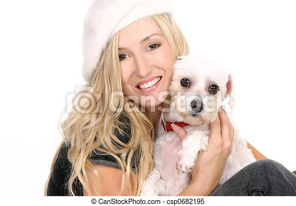 Sitting girl cuddling a dog - csp0682195