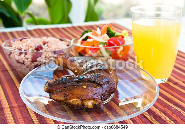 Jerk Chicken with Vegetables, Rice and Lemonade - csp0684549