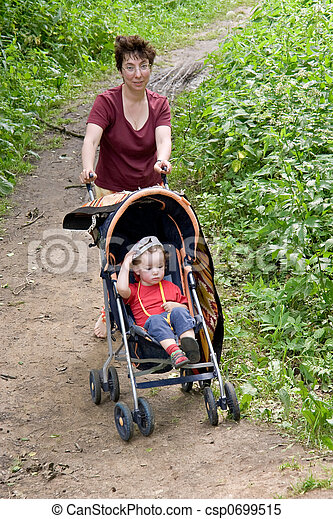 Mum and child in a walking carriage - csp0699515