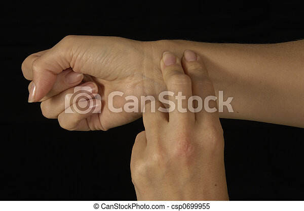 Female shown taking her own pulse - csp0699955