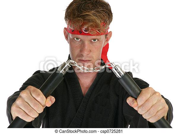 Martial arts man with nun chucks - csp0725281