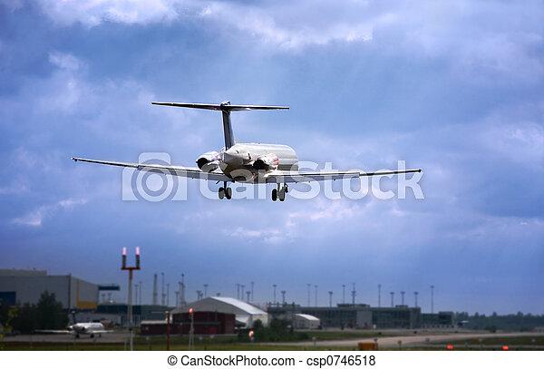 jet landing at dusk. - csp0746518