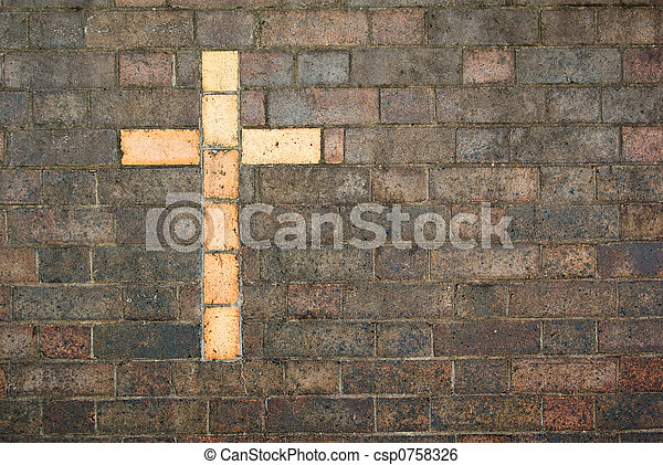 cross of christ built into a brick wall - csp0758326