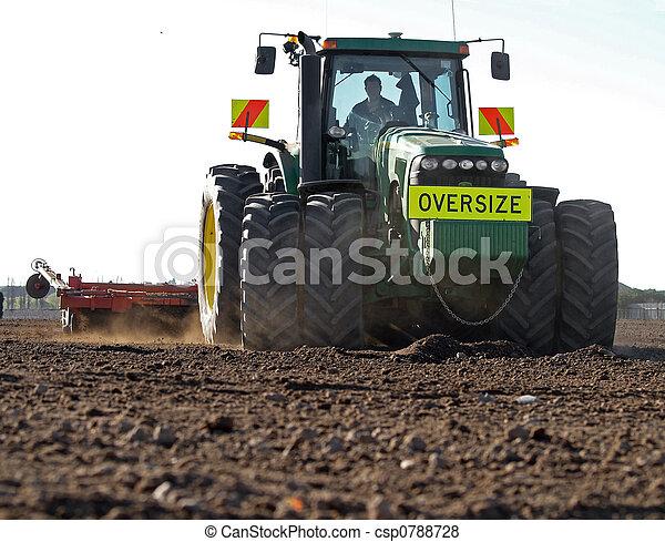 Large Tractor Preparing Soil - csp0788728