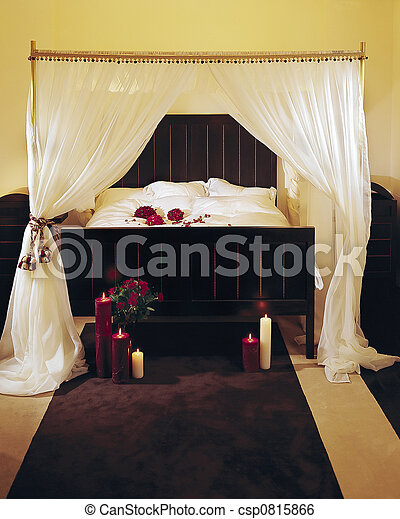 a fancy bed with a canopy - csp0815866