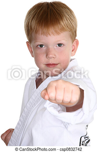 Boy making karate punch towards camera. included.