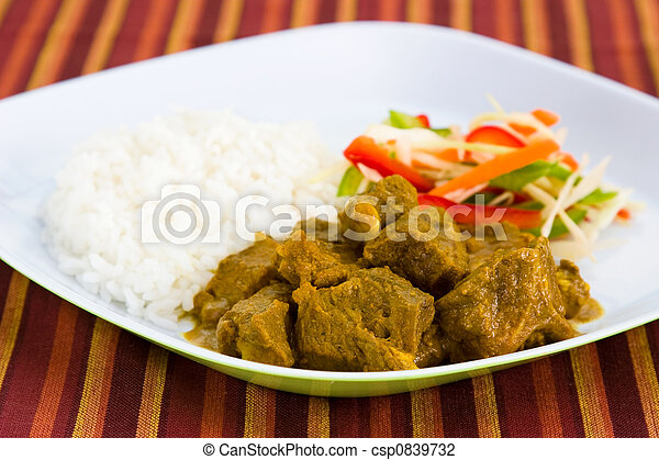 Goat Curry with Rice - Caribbean Style - csp0839732