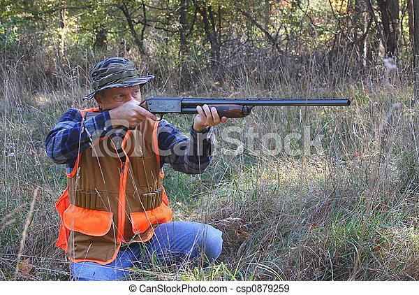 Kneeling Hunter Shooting - csp0879259