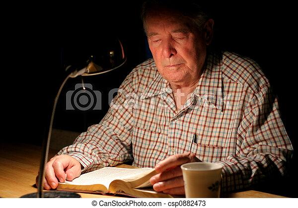 Elderly man reading Bible - csp0882473