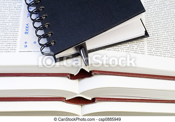 Notebook and Pen on Books - csp0885949
