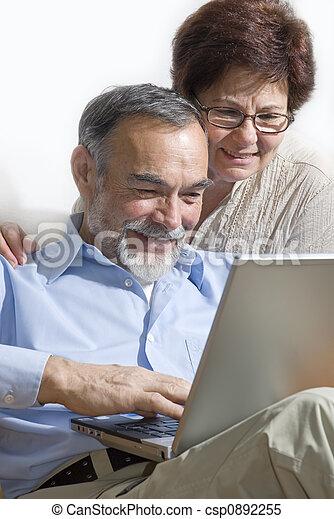 Senior couple on laptop - csp0892255