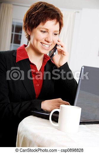 bilder von auf telefon frau telefon laptop gleich zeit csp0898828 suchen sie stock. Black Bedroom Furniture Sets. Home Design Ideas