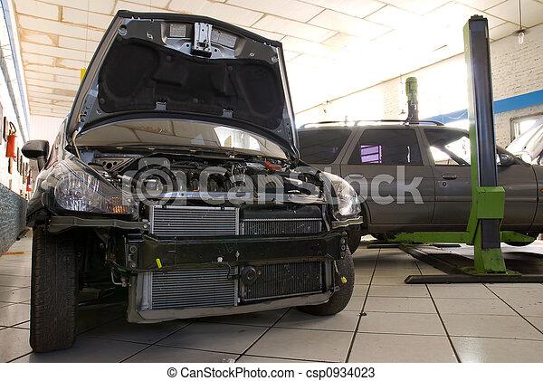 Modern Black Car in a Repair Shop - csp0934023