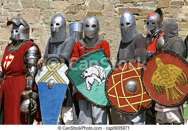 several knights on stone wall background - csp0935971