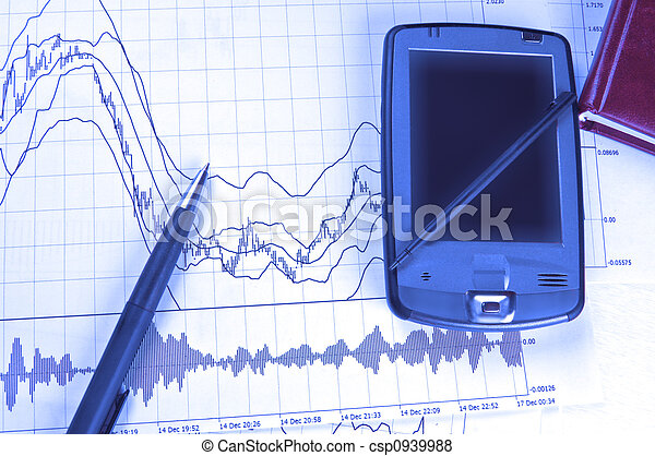 PDA and pen on stock chart - csp0939988