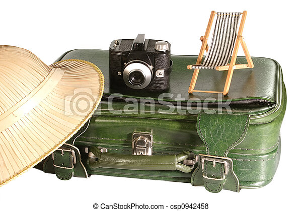 Old suitcase with safari hat and little deck chair on light background