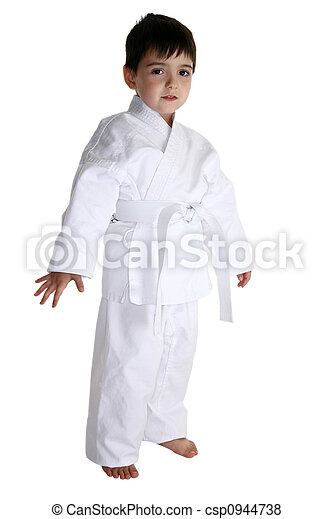 Four year old boy dressed in karat gi uniform over white..